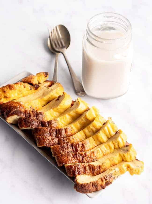 slices of egg loaf on a white background with a glass of milk