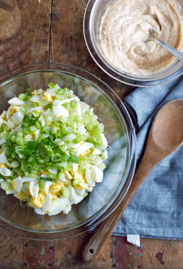 egg salad in bowl on background