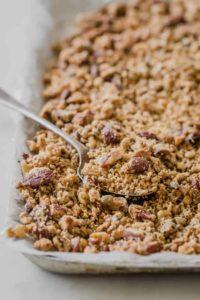keto granola on baking sheet