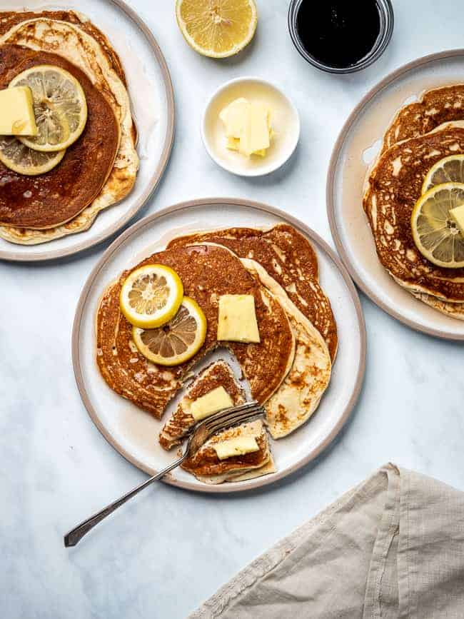 Keto cream cheese pancakes on plate with butter